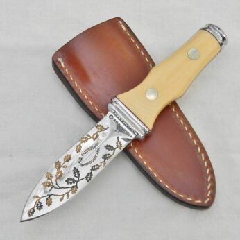 AG Russell 1977 Sting boot knife gold
